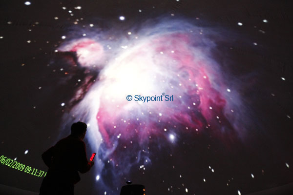 Picture taken under a 8m Go-Dome inflatable dome with a real Digitarium system representing the Great Orion Nebula.